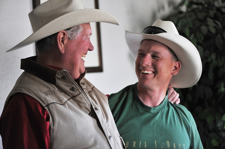 U.S. Army Sgt. Dale Chick (right) shares a light moment with Billy Jack Barrett at the equestrian center April 27, 2012, at the U.S. Air Force Academy in Colorado Springs, Colo. Chick said that volunteering at the stables and working with horses help them find inner peace and comfort after being deployed in Iraq and Afghanistan. Barrett is the director of the center. (U.S. Air Force photo/Val Gempis)