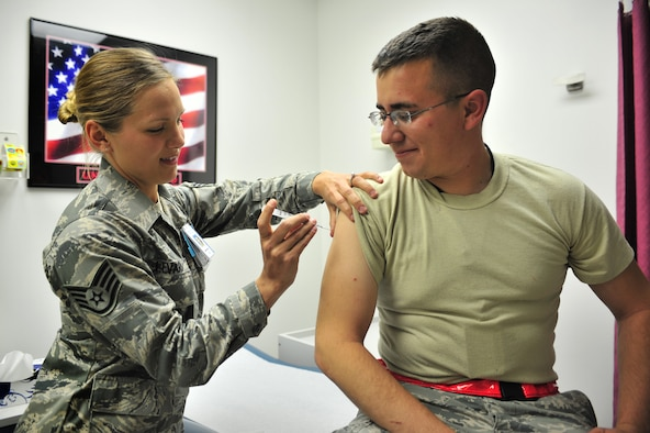 U.S. Air Force Staff Sgt. Dena Levari, 27th Special Operations Medical Operations Squadron NCOIC of immunizations, prepares to vaccinate 2nd Lt. Jose Valadez, 27th Special Operations Aircraft Maintenance Squadron, with Gardasil in the clinic at Cannon Air Force Base, N.M., May 29, 2012. The Gardasil vaccine protects against four types of the Human Papillomavirus and has recently been cleared for use on males. (U.S. Air Force photo by Airman 1st Class Alexxis Pons Abascal)