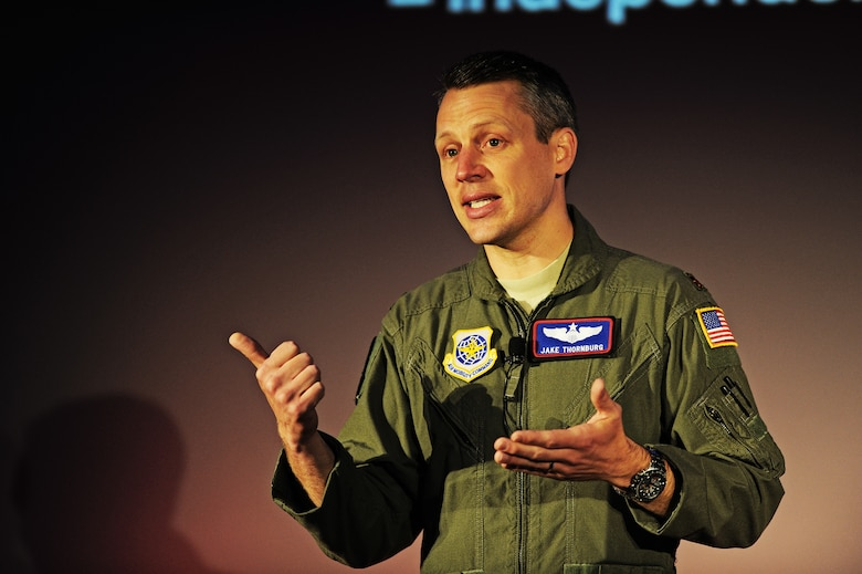 Maj. Jake Thornburg, 62nd Airlift Wing instructor pilot, speaks to the audience during a TEDx talk at Scott Air Force Base, Ill. May 30 about his experience with an honorable return mission where he transported the remains of 19 flag-draped caskets of men who died while serving in Afghanistan.  He maintains expertise in mission preparation, aircraft systems, in-flight refueling, low-altitude and austere airfield operations in the C-17A. (U.S. Air Force photo/ Staff Sgt. Ryan Crane)