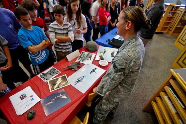 U.S. Air Force Senior Airman Tina Fryling from the 177th Fighter Wing, New Jersey Air National Guard, discusses her recent deployment to Afghanistan with students at Alder Middle School in Egg Harbor Township, NJ on May 23.  Alder Middle school showed it's pride and patriotism by inviting military members to display work equipment and memorabilia and to share stories with students.  U.S. Air Force photo/Tech. Sgt. Matt Hecht