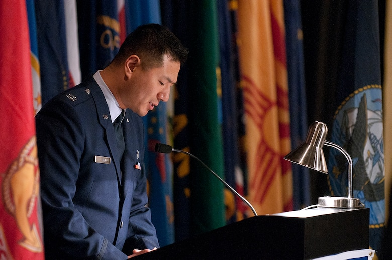 Chaplain (Capt.) Myung Cho, 90th Missile Wing, gives the invocation at the Air Force Association's Armed Forces Day Banquet in the Cheyenne Holiday Inn May 18. (U.S. Air Force photo by R.J. Oriez)