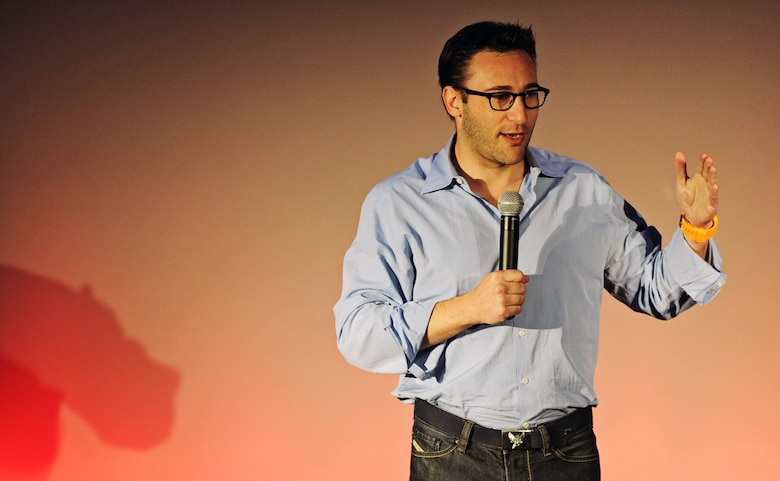 Simon Sinek, event emcee and public speaker gives the audience an introduction to the TEDx event at Scott Air Force Base, Ill. May 30. With a bold goal to help build a world in which the vast majority of people go home everyday feeling fulfilled by their work, Sinek is leading a movement to inspire people to do the things that inspire them. (U.S. Air Force photo/ Staff Sgt. Ryan Crane)