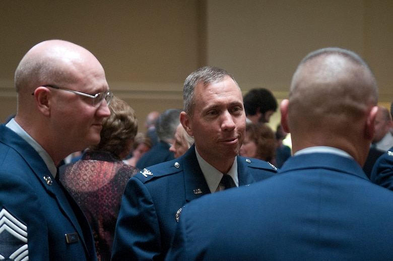 Col. Tom Wilcox, 90th Security Forces Group commander, and Chief Master Sgt. Daniel Arvin, 90th Security Forces Group chief enlisted manager, are among the F. E. Warren Airmen socializing prior to the start of the Air Force Association's Armed Forces Day Banquet in the Cheyenne Holiday Inn May 18. (U.S. Air Force photo by R.J. Oriez)