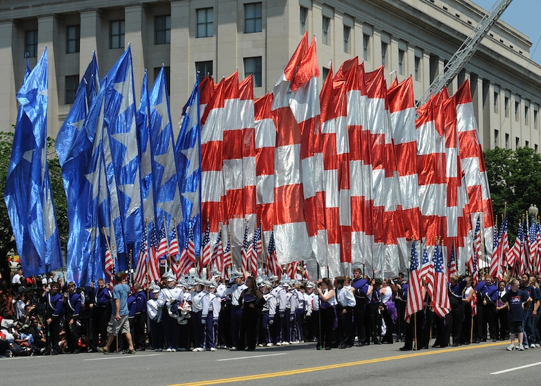 A precession of flags is carried by volunteers at the National Memorial Day Parade on May 28, 2012 in Washington D.C. The annual National Memorial Day Parade is an opportunity for thousands of patriotic Americans to come together and honor those who have sacrificed so much in service to our country.