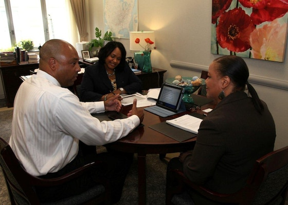 WASHINGTON — Tim Goodrich (left), is the president of Timitron Corp., a service-disabled veteran-owned small business.  He is briefing Jackie Robinson-Burnette, chief of the USACE Small Business Program, and Simone Jackson, chief of Small Business Policy, about his firm's capabilities and his interest in doing business with USACE.
