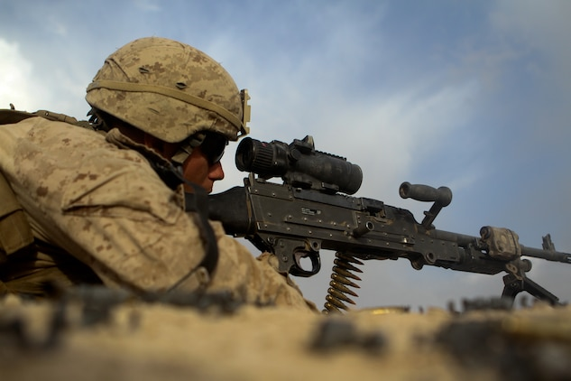 Lance Cpl. Kyle Prather, a team leader with 2nd Battalion, 5th Marine Regiment, sights into his M240B machine gun, during a firefight, May 30, 2012. The Marines engaged enemies with machine guns, sniper rifles, mortars and tanks.