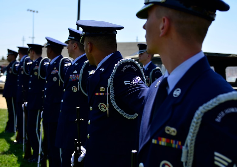 Airmen from the Beale Base Honor Guard lineup to perform a 3-shot volley salute during a Memorial Day ceremony at the Calvary Christian Center, Yuba City, Calif., May 28, 2012. The ceremony was held to honor fallen warriors.  (U.S. Air Force photo by Airman1st Class Ayla Quellhorst/Released)