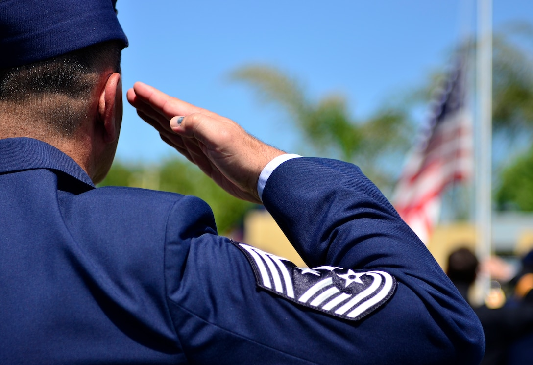 Chief Master Sgt. Robert White, 9th Reconnaissance Wing command chief, salutes the American Flag during a Memorial Day ceremony at the Calvary Christian Center, Yuba City, Calif., May 28, 2012. White is one of many Airmen from Beale to attend the closing ceremony for fallen warriors. (U.S. Air Force photo by Airman1st Class Ayla Quellhorst/Released)