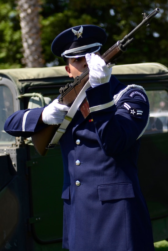 Airman 1st Class Jose Lopez takes part in a 3-shot volley salute during a Memorial Day ceremony at the Calvary Christian Center, Yuba City, Calif., May 28, 2012. The closing ceremony ends the week long service to honor fallen warriors. (U.S. Air Force photo by Airman1st Class Ayla Quellhorst/Released)