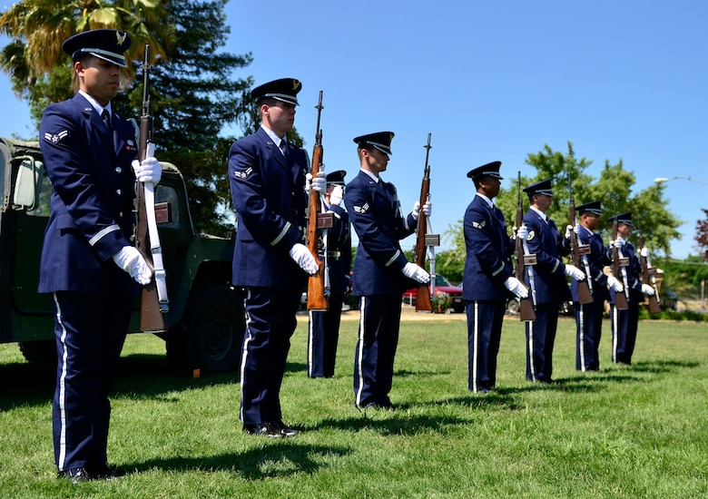 Airmen from the Beale Base Honor Guard present arms during a Memorial Day ceremony at the Calvary Christian Center, Yuba City, Calif., May 28, 2012. The firing party was part of the closing ceremonies to honor fallen warriors. (U.S. Air Force photo by Airman1st Class Ayla Quellhorst/Released)