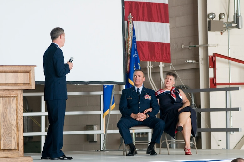 "GRISSOM AIR RESERVE BASE, Ind. -- Col. William T. ""Tim"" Cahoon, 434th Air Refueling Wing commander, and his wife Vicki listen to retired Col. Ronald Farris speak during Cahoon's retirement ceremony May 20 at Grissom. Cahoon retired after nearly 35 years of service in the Air Force. (U.S. Air Force photo/Senior Airman Andrew McLaughlin)"