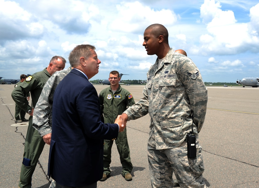 Airman 1st Class Rodrick Defreitas, 628th Logistics Readiness Squadron, meets U.S. Sen. Lindsey Graham from South Carolina upon his arrival May 29, 2012 to JB Charleston, S.C. Graham visited the base to have an open forum with JB Charleston leadership. (U.S. Air Force photo/Airman 1st Class Ashlee Galloway)