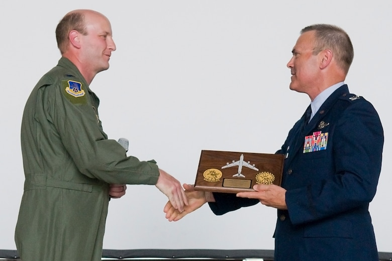 "GRISSOM AIR RESERVE BASE, Ind. -- Col. Christopher Amend, left, shakes the hand of Col. William T. ""Tim"" Cahoon after giving him the ""highly coveted"" 434th Operations Group plaque during Cahoon's retirement ceremony here May 20. Amend is the 434th OG commander.  (U.S. Air Force photo/Senior Airman Jami K. Lancette)"