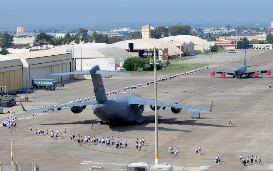 Airmen spread out around the flightline to begin a foreign-object-debris walk to remove trash and other objects from the area May 29, 2012, at Incirlik Air Base, Turkey. The FOD walk was a combined effort between the 39th Air Base Wing and Turkish air force 10th Tanker Base Command to clear the area of  debris that could potentially damage aircraft engines. (U.S. Air Force photo by Senior Airman Marissa Tucker/Released)