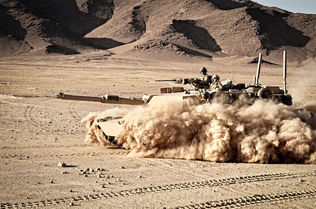An M1A1 Abrams tank with Alpha Company, 1st Tank Battalion, Regimental Combat Team 6, patrols through the desert north of the Kajaki Dam, May 31. The Marines supported Operation Branding Iron.