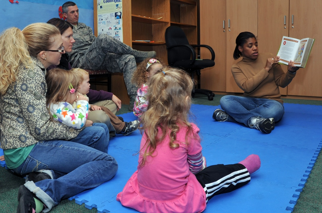 Tiffany Hagarty reads to children as part of preschool story time hosted by the base library, Nov. 1, 2012. Haggarty took lead position in the program and feels it boosts social interaction among children. (U.S. Air Force photo/Staff Sgt. Craig Cisek)