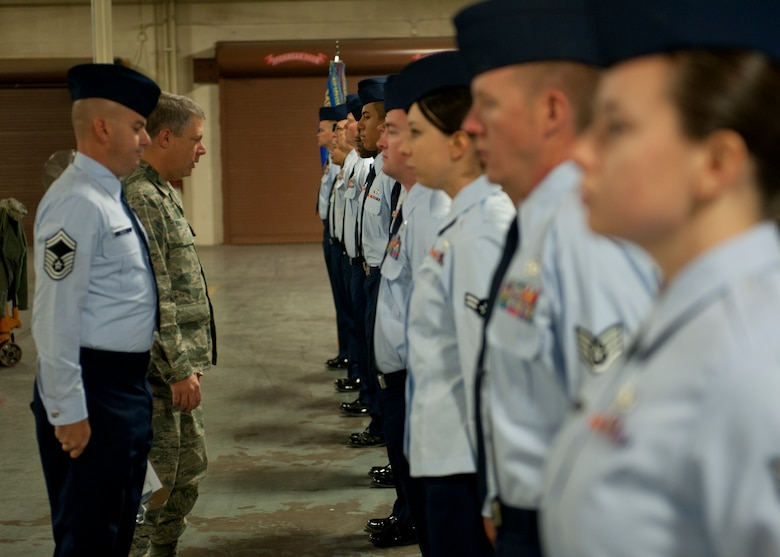 Colonel Kevin Bennett, 49th Mission Support Group commander, performs an open-ranks uniform inspection of Airmen in the 49th Logistics Readiness Squadron at Holloman Air Force Base, N.M., Oct. 30. Representatives of all grades in both the enlisted and officer tiers were chosen from every 49th LRS flight to have their uniforms inspected. (U.S. Air Force photo by Airman 1st Class Daniel E. F. Liddicoet)