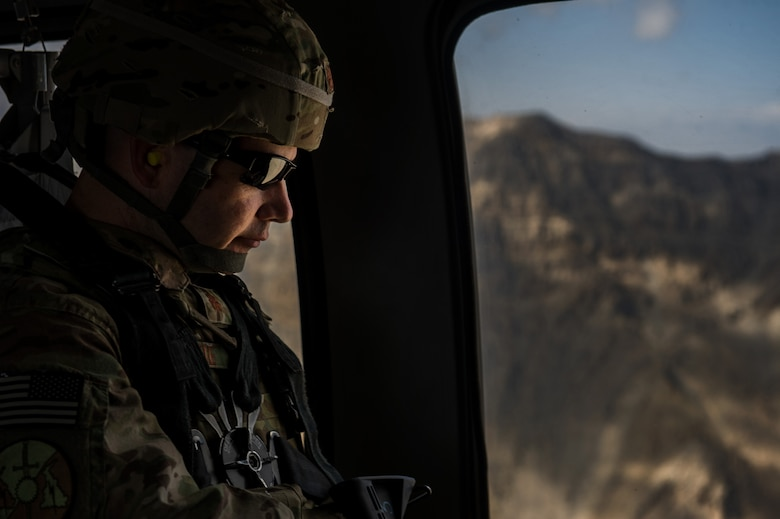U.S. Air Force Maj. Ryan Kehoe, 19th Expeditionary Weather Squadron, director of operations, travels on a U.S. Army UH-60 Black Hawk back to Bagram Airfield after visiting with 19th EWS Airmen at remote forward operating bases on Oct. 16, 2012, over Afghanistan. The 19th EWS provides Army ground commanders with accurate and real-time weather conditions and offers alternative options to help commanders make informed decisions on combat operations. (U.S. Air Force photo/Staff Sgt. Jonathan Snyder)