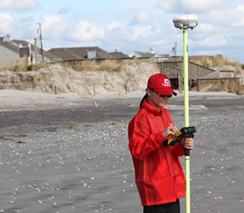 Survey Technician Angelica De-Hoyos Molina uses GPS to survey damages along the New Jersey shore following historic Hurricane Sandy.