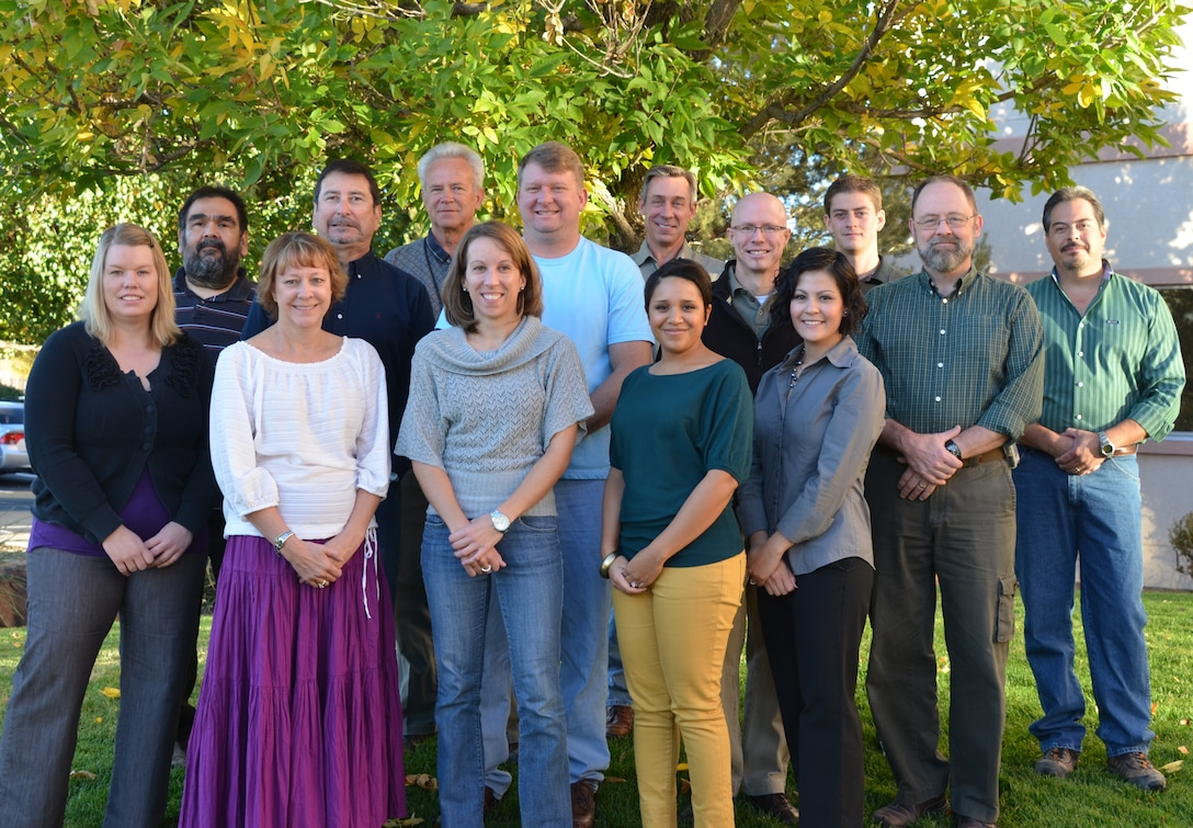 Albuquerque District's reach back team consists of: (back row) Paul Rebarchik, Lance Faerber, James Vigil (middle row) Ben Alanis, Art Maestas, Bruce Jordan, Bill Loveland, Jim Marshall, Chris Velasquez (front row) Regina Schowalter, Kathy Mayer, Karen Irving, Francesca Thomas, and Diana Keeran. Not pictured: Charles Agee, Richard Banker, Steve Buckel, Tom Bueno, Corina Chavez, Bryan Estvanko, Paul Gendron, Tim Kreitinger, Matthias Mayerhofer, Sonia Murdock, Stephanie Padilla, Brian Sanchez, and Erica Talley.