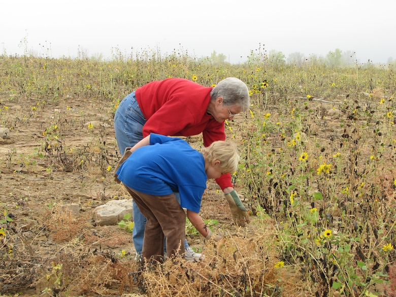 JOHN MARTIN RESERVOIR, COLO., -- Volunteers Deborah West and her granddaughter Kyra Bierbaum pulled weeds and sunflowers on the south shore of John Martin Reservoir to help promote critical nesting habitat for the Piping Plover and Interior Least Tern at the 2012 National Public Lands Day event held at the reservoir.