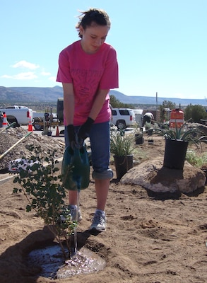 COCHITI LAKE, N.M., -- Volunteer Adrianne Bonham helps plant desert vegetation to improve landscaping at Cochiti at the National Public Lands Day event held there, Sept. 29, 2012.
