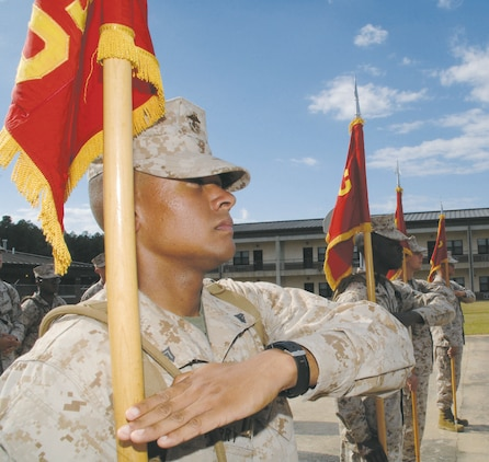 Seventeen Marines, participating in their first professional military education course, the Corporals Course, train many hours practicing basic drill movements and learning the proper use of the NCO sword and guidon for formations and ceremonies.