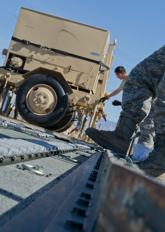 Personnel of the 49th Materiel Maintenance Squadron, load a pallet onto a 60,000-pound K-Loader at Holloman Air Force Base, N.M., Nov. 2. The 49th MMS was tasked with supporting the humanitarian relief efforts for the victims of Hurricane Sandy. In response to the tasking, the 49th MMS worked for 15 straight hours preparing more than 58,000 pounds of cargo spread across eight pallets. The cargo consisted of two water pumps capable of pumping 400 gallons of water a minute, 12,000 feet of hose, and two containers of system support items. (U.S. Air Force photo by Senior Airman DeAndre Curtiss/Released)