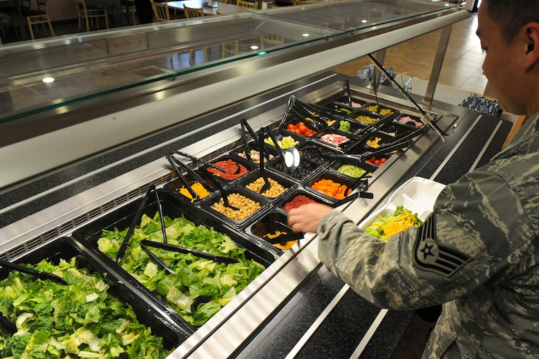 An Airman makes a salad in the Red River Dining Facility on Barksdale Air Force Base, La., Oct. 31. The Red River Dining Facility offers a wide variety of food for Team Barksdale to enjoy. The dining facility service hours for breakfast are from 6 a.m. to 8 a.m., lunch is served from 11 a.m. to 1 p.m., dinner is served from 5 p.m. to 7 p.m. and midnight dining hours are from 10:30 p.m. to 1 a.m. (U.S. Air Force photo/Senior Airman Micaiah Anthony)(RELEASED)