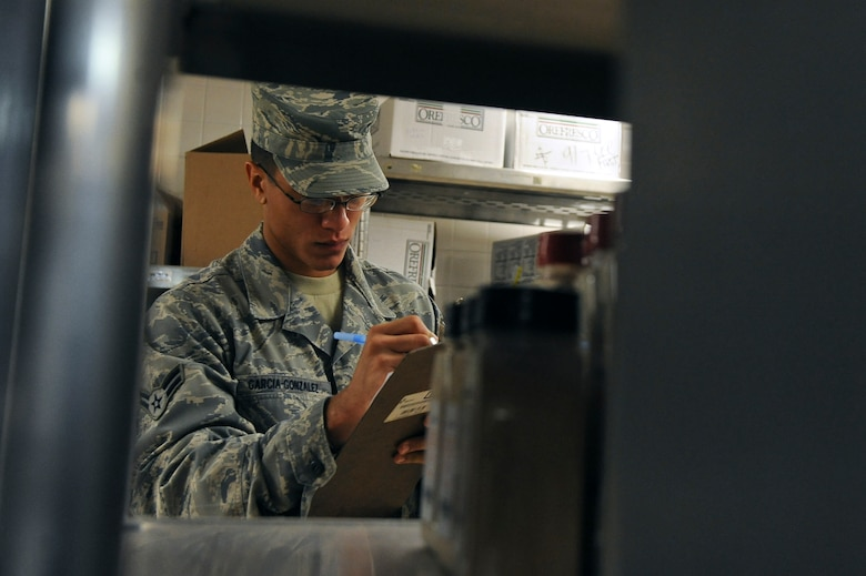 Airman 1st Class Jorge Garcia-Gonzalez, 2nd Force Support Squadron, takes inventory of food supplies in the Red River Dining Facility on Barksdale Air Force Base, La., Oct. 31. At the end of each month, an inventory of all the food is conducted to make sure everything is accounted for. (U.S. Air Force photo/Senior Airman Micaiah Anthony)(RELEASED)