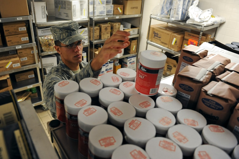 Airman 1st Class Jorge Garcia-Gonzalez, 2nd Force Support Squadron, reaches for a container of salt in the Red River Dining Facility on Barksdale Air Force Base, La., Oct. 31. At the end of each month, an inventory of all the food is conducted to make sure everything is accounted for. (U.S. Air Force photo/Senior Airman Micaiah Anthony)(RELEASED)