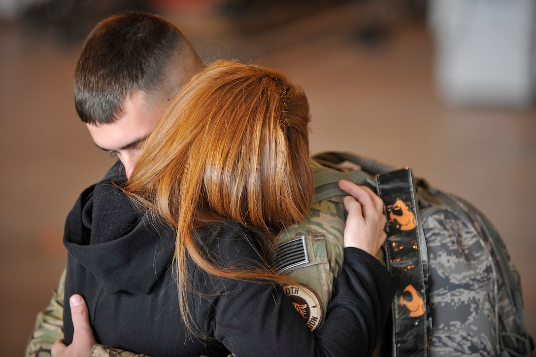 U.S. Air Force Airman 1st Class Sean McCracken, 140th Maintenance Squadron, hugs his wife, LaCie goodbye at Buckley Air Force Base Colo., Nov 1, 2012.  Members of the 140th Wing, Colorado Air National Guard, have been taking off from Buckley AFB, Colo. this week, headed to a forward operating location in support of Air Force Central Command. These pilots, aircraft maintainers and support personnel will be deployed throughout the holiday season in order to support the ongoing Overseas Contingency Operations. (Colorado Air National Guard photo by Tech. Sgt. Wolfram M. Stumpf)