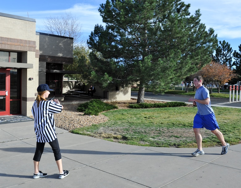 BUCKLEY AIR FORCE BASE, Colo. – Heather Huckstep, left, Buckley Fitness Center recreational assistant, congratulates Capt. John Radar, 566th Intelligence Squadron, as he wins Buckley's Dreadful Dash 5K Oct. 31, 2012. The race started at the fitness center track and concluded at the community center. (U.S. Air Force photo by Senior Airman Christopher Gross)