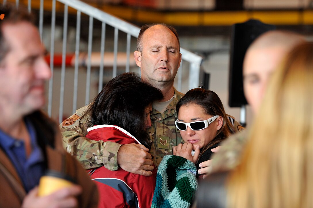 U.S. Air Force Staff Sgt. Rob Bruning, 140th Maintenance Squadron, hugs his wife and daughter goodbye at Buckley Air Force Base Colo., Nov 1, 2012.  Members of the 140th Wing, Colorado Air National Guard, have been taking off from Buckley AFB, Colo. this week, headed to a forward operating location in support of Air Force Central Command. These pilots, aircraft maintainers and support personnel will be deployed throughout the holiday season in order to support the ongoing Overseas Contingency Operations. (Colorado Air National Guard photo by Tech. Sgt. Wolfram M. Stumpf)