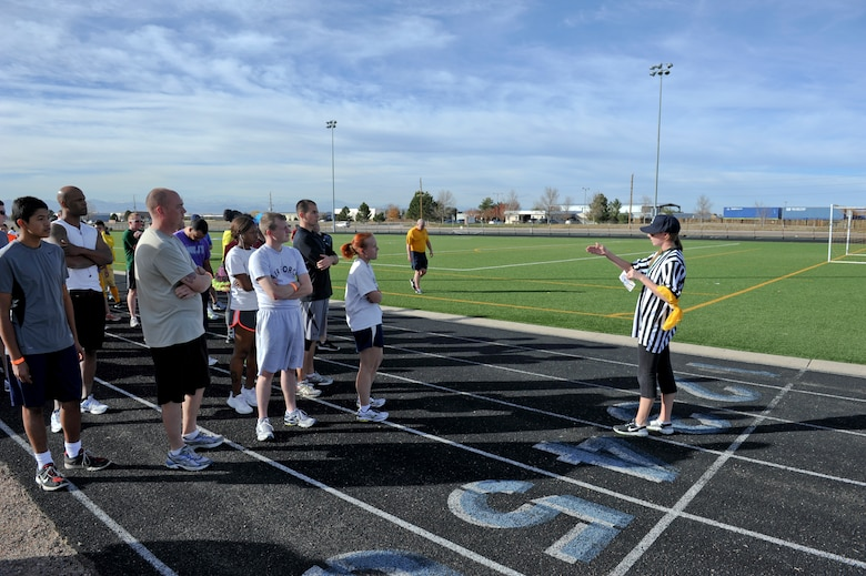 BUCKLEY AIR FORCE BASE, Colo. – Heather Huckstep, right, Buckley Fitness Center recreational assistant, reads instructions to runners before the start of Buckley's Dreadful Dash 5K Oct. 31, 2012, at the fitness center track. Capt. John Radar, 566th Intelligence Squadron, won the race. (U.S. Air Force photo by Senior Airman Christopher Gross)