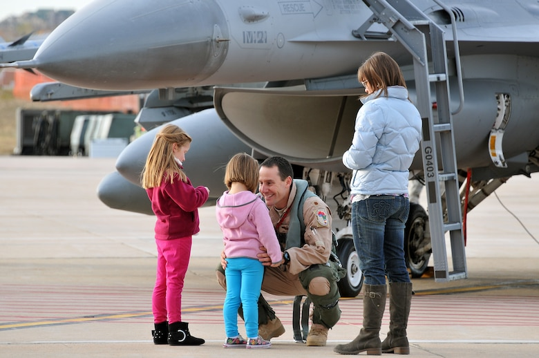 """U.S. Air Force Maj. Mike """"Stiffler"""" Gommel, 120th Fighter Squadron, says goodbye to his daughters, Dylan (left) and Harlie (center) and his wife, Jennifer at Buckley Air Force Base Colo., Nov 1, 2012.  Members of the 140th Wing, Colorado Air National Guard, have been taking off from Buckley AFB, Colo. this week, headed to a forward operating location in support of Air Force Central Command. These pilots, aircraft maintainers and support personnel will be deployed throughout the holiday season in order to support the ongoing Overseas Contingency Operations. (Colorado Air National Guard photo by Tech. Sgt. Wolfram M. Stumpf)"""