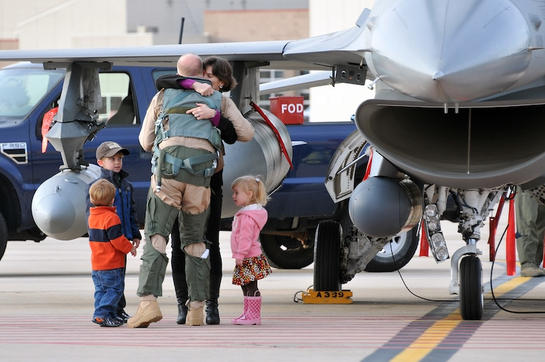 """U.S. Air Force Maj. TenEyck """"Thor"""" LaTourrette, 120th Fighter Squadron, gives his wife, U.S. Air Force Lieutenant Col. Tracy LaTourrette a good bye hug along with their three children at Buckley Air Force Base Colo., Nov 1, 2012.  Members of the 140th Wing, Colorado Air National Guard, have been taking off from Buckley AFB, Colo. this week, headed to a forward operating location in support of Air Force Central Command. These pilots, aircraft maintainers and support personnel will be deployed throughout the holiday season in order to support the ongoing Overseas Contingency Operations. (Colorado Air National Guard photo by Tech. Sgt. Wolfram M. Stumpf)"""