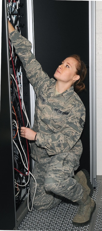 U.S. Air Force Staff Sergeant Carley Bolitho, 612th Air Communications Maintenance Squadron communications control administrator, checks the wiring at the back of a server on Davis-Monthan Air Force Base, Ariz., Nov. 1, 2012. The 612th ACOMS handles communications issues for the 612th Air Communications Squadron. (U.S. Air Force photo by Airman 1st Class Saphfire Cook/Released)