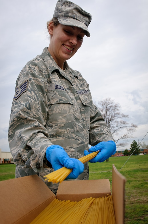 Senior Airman Amanda Bedel of the 123rd Force Support Squadron prepares to cook spaghetti during training on a new field kitchen at the Kentucky Air National Guard Base in Louisville, Ky., on March 16, 2012. The kitchen can be deployed to the site of a natural disaster to provide hot meals for relief workers. (U.S. Air Force photo by Senior Airman Maxwell Rechel)