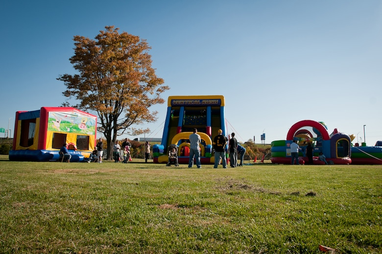 Airmen and their families enjoy 2012 Family Day at the Kentucky Air National Guard Base in Louisville, Ky., on Oct. 21, 2012. The day?s featured attractions included bounce houses, photos with Santa and a picnic lunch. (U.S. Air Force photo by Senior Airman Maxwell Rechel)