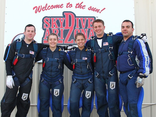 The Wings of Blue's Air Force Paradigm team took first place this week in the 4-Way Formation Skydiving (Advanced Category) at the U.S. Parachuting Association Nationals Competition.  The Wings of Blue is the U.S. Air Force's Parachute Team and is operated by the 98th Flying Training Squadron at the U.S. Air Force Academy, Colo.  From left to right:  Cadets 1st Class Dustin Weeks, Erin Brown, John Skeele, and Dani Griffith, and team cameraman, Tech. Sgt. JT Valente. (Courtesy Photo)