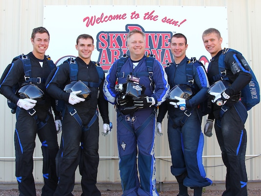 The Wings of Blue's Air Force Legacy team took second place this week in the 4-Way Formation Skydiving (Advanced Category) at the U.S. Parachuting Association Nationals Competition.  The Wings of Blue is the U.S. Air Force's Parachute Team and is operated by the 98th Flying Training Squadron at the U.S. Air Force Academy, Colo.  From left to right:  Cadets 1st Class Jeremy Krohngold and Travis Grindstaff,  team cameraman Master Sgt. Bryan Stokes, and Cadets 1st Class Brett Brunner and Kyle Land. (Courtesy Photo)