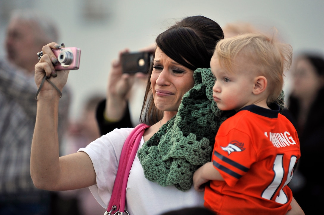 Ms. Amanda Palmer and her son, Brayden watch as her husband, U.S. Air Force Staff Sgt. Michael Palmer, 140th Maintenance Squadron, takes off for a deployment at Buckley Air Force Base Colo., Nov 1, 2012.  Members of the 140th Wing, Colorado Air National Guard, have been taking off from Buckley AFB, Colo. this week, headed to a forward operating location in support of Air Force Central Command. These pilots, aircraft maintainers and support personnel will be deployed throughout the holiday season in order to support the ongoing Overseas Contingency Operations. (Colorado Air National Guard photo by Tech. Sgt. Wolfram M. Stumpf)