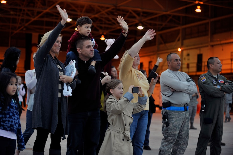 Friends and family wave goodbye to their loved ones at Buckley Air Force Base Colo., Nov 01, 2012.  Members of the 140th Wing, Colorado Air National Guard, have been taking off from Buckley AFB, Colo. this week, headed to a forward operating location in support of Air Force Central Command. These pilots, aircraft maintainers and support personnel will be deployed throughout the holiday season in order to support the ongoing Overseas Contingency Operations. (Colorado Air National Guard photo by Tech. Sgt. Wolfram M. Stumpf)
