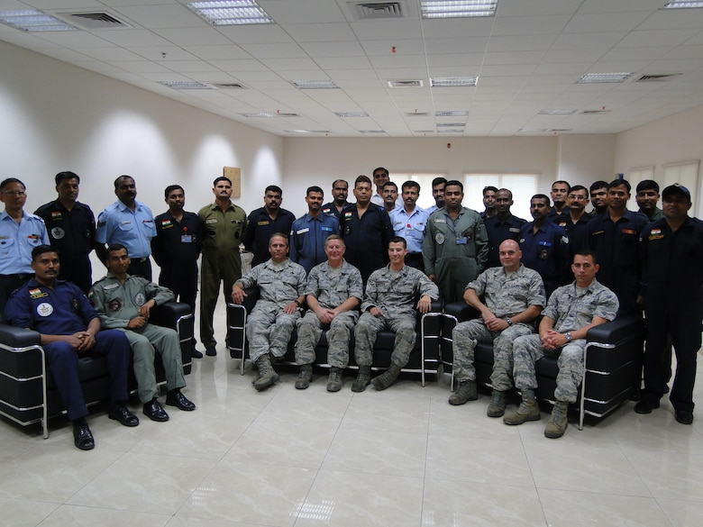 Master Sergeant Joe Delfino, Technical Sergeant Kevin Hunt, Staff Sergeant Matt Elderkin, Chief Master Sergeant Carlos Moniz and Captain Chris Peloso, all of the 143d Maintenance Group and members of the Mobile Training Team for the Indian Air Force, pose with some of their students. Provided photo.