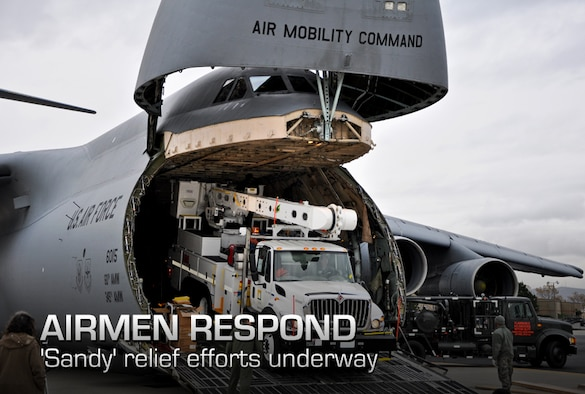 Air Force crews offload Southern California Edison power repair equipment from a C-5 Galaxy on Stewart Air National Guard Base in Newburgh, N.Y., Nov. 1, 2012. The Defense Department initiated the airlift operation to aid recovery efforts in Hurricane Sandy's aftermath. (U.S. Army photo/Master Sgt. Corine Lombardo)