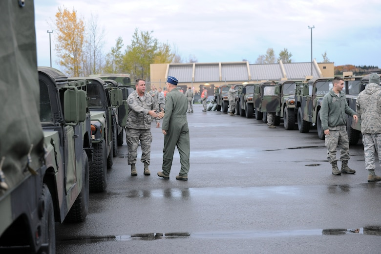 New York Air National Brig.Gen. Kevin Bradley (flight suit) thanks members of Hancock Field Air National Guard Base, Syracuse, New York as they prepare to deploy to New York City to support Hurricane Sandy relief efforts. (Photo by New York Air National Guard Tech. Sgt. Jeremy Call/Released).