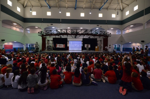 ANDERSEN AIR FORCE BASE, Guam—Andersen Elementary School students listen as members of Team Andersen speak about the dangers of drugs as part of Red Ribbon Week here, Oct. 23. Each year, the school participates in Red Ribbon Week to educate students on the dangers of drugs and drug use. (U.S. Air Force photo by Senior Airman Benjamin Wiseman/Released)