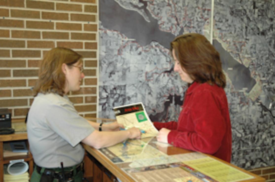 Park Ranger Assisting Visitor