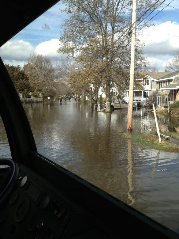 Flood waters can be seen in a Southern Connecticut town from one of the Orange-based 103rd Air Control Squadron's high-wheeled vehicles that responded in the wake of Super Storm Sandy Nov. 1, 2012. (Photo courtesy of Maj. Joe Sorrentino)